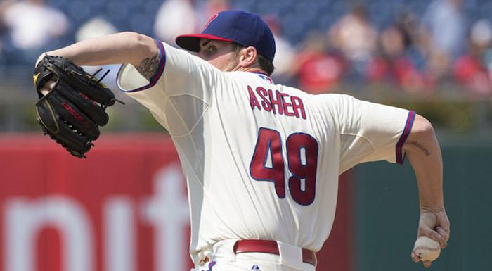Alec Asher, who pitched for Polk State, delivers a pitch during his first major-league game. (Photo by Chris Szagola, AP.)