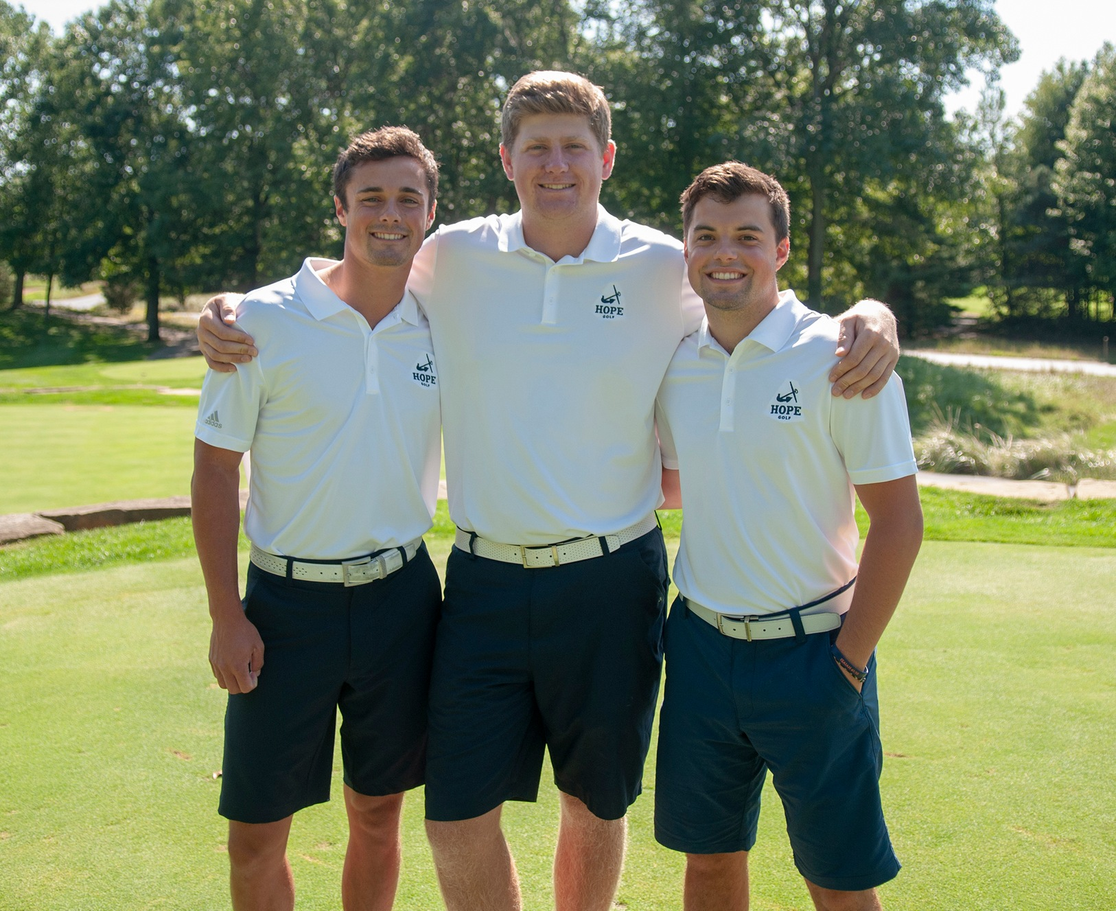 Ben Kramer, Josh Gibson and Andrew Goble pose together on the first tee at Wuskowhan Players Club