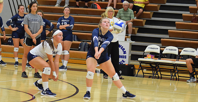 Corinne Frick '21 digs up a ball against Wilkes University.