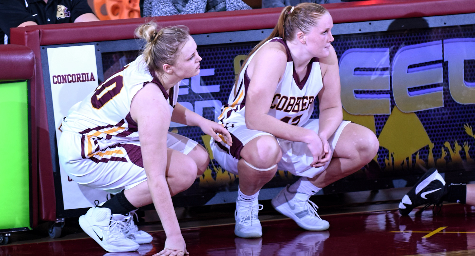 Kirstin Simmons (R) and Mira Ellefson combined for 25 points and helped the Cobbers outrebound Hamline 39-25 in their conference-opening win.