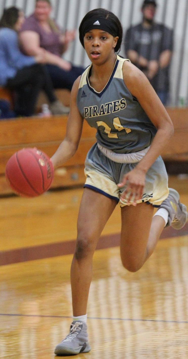 Kierra Crockett (24) brings the ball up the floor. Photo Credit: Nick Dailey