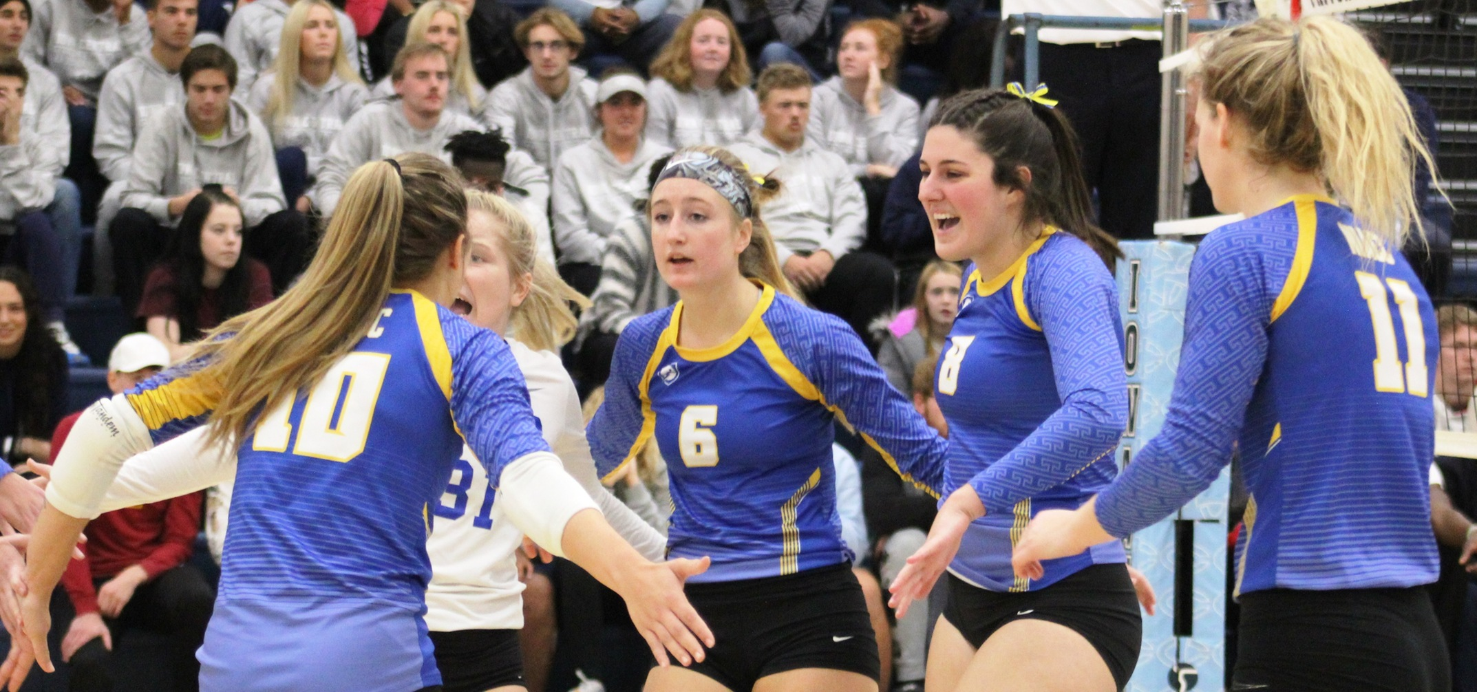 NIACC celebrates a point in Wednesday's match at Iowa Central.