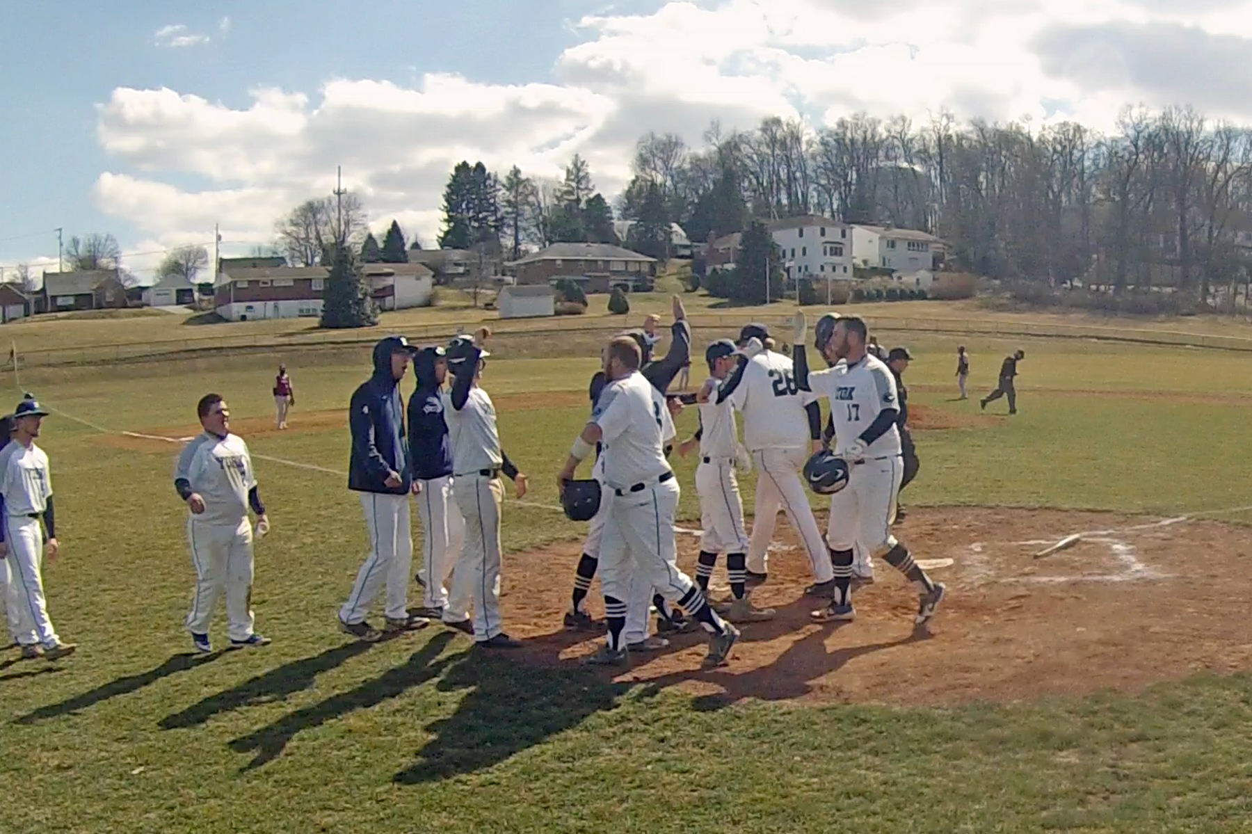 Teammates congratulate Brendon Delridge (#17) after his fifth-inning two-run home run.