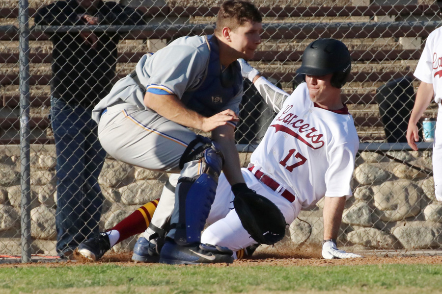 Lancer Daniel Netz slides into home for a run in a recent game, photo by Richard Quinton.