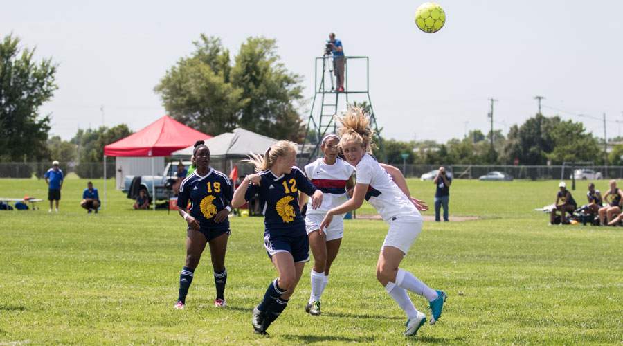Sheena Nichol strikes a header for the match's first goal in a 6-0 Blue Dragon victory over Trinidad State on Sunday at the Salthawk Sports Complex. (Allie Schweizer/Blue Dragon Sports Information)