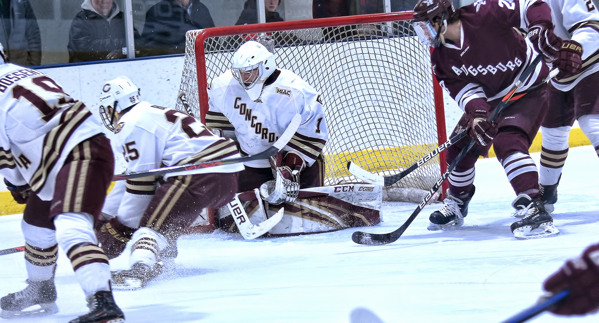 Senior Jacob Stephan goes to the ice to make the save in the first period of the Cobbers' 2-1 win against #15 Augsburg in the series finale. Stephan finished with 35 saves.