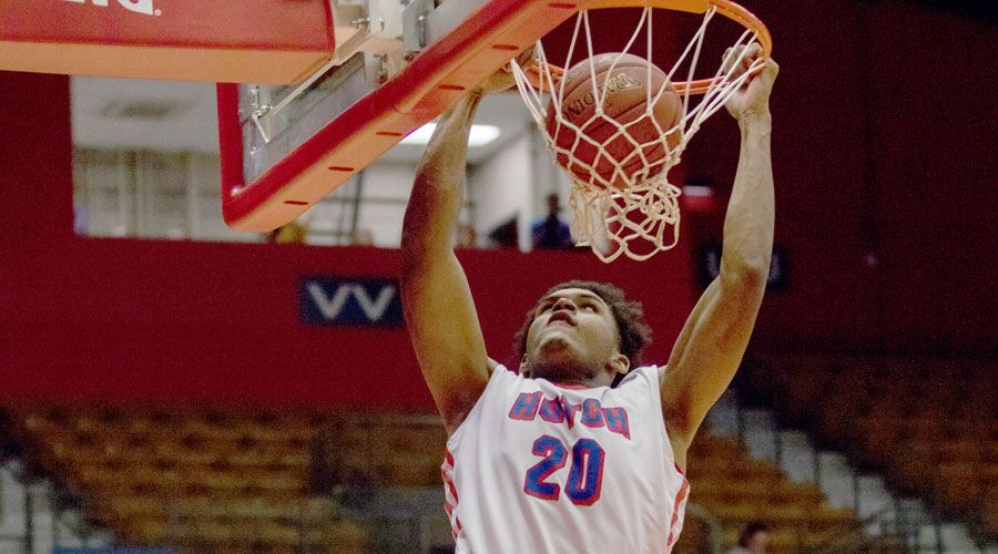 Sophomore Kai Mitchell dunks in the first half of No. 1 Hutchinson's 102-56 season-opening victory over the Friends University JV on Wednesday at the Sports Arena. (AllieSchweizer/Blue Dragon Sports Information).