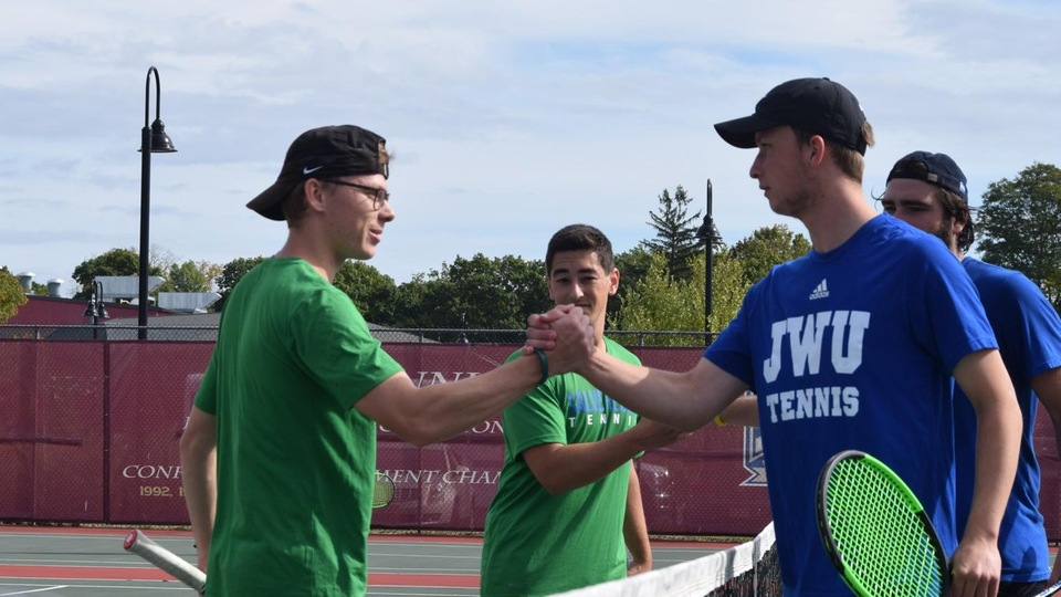 Will Chasse and Benjamin Resende offer congratulations after their No. 1 doubles match with the Wildcats. (Photo by Ed Habershaw)