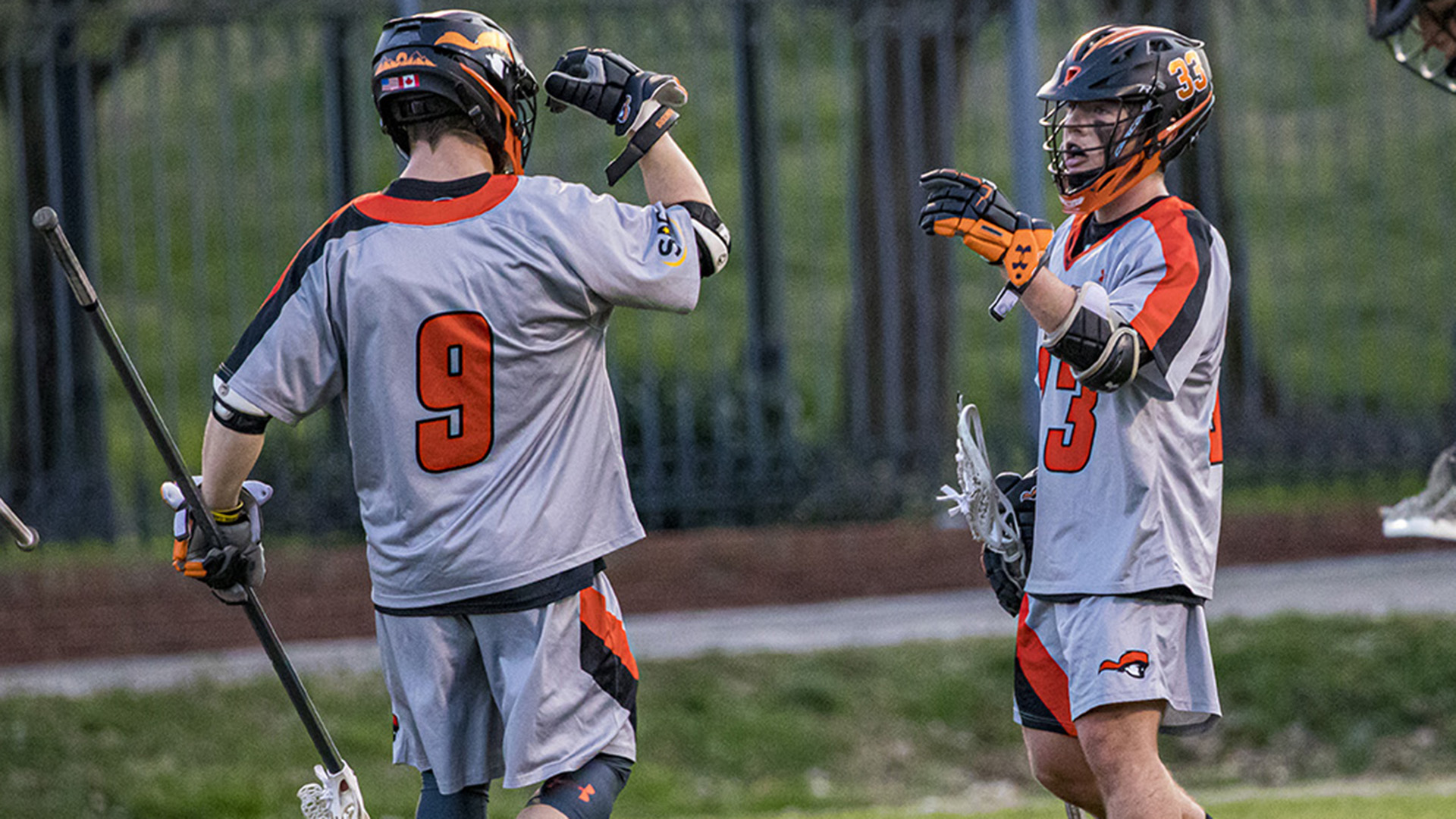 Kale Lawrence receives congratulations from Joel Edgar after one of his six second-quarter goals against Lees-McRae (photo by Chuck Williams)