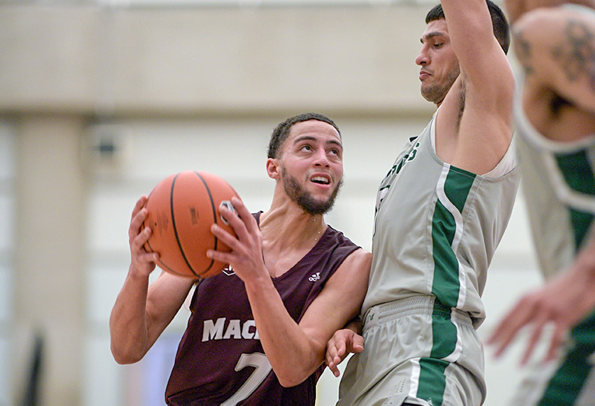 Jake Notice looks for an opening against UFV on Saturday night. He scored a game-high 24 points as the Griffins fell just short of their first win of the season (Chris Piggott photo).