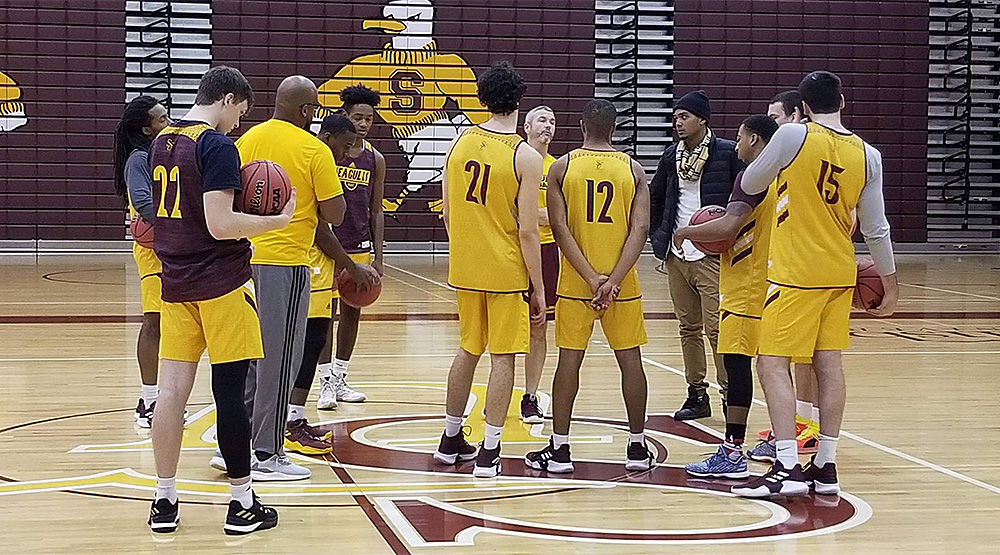 Salisbury men's basketball team at practice, with a new face in the middle.