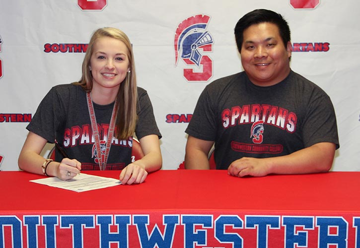 PICTURED: Chelsey Trautloff and Casey Quiggle, Southwestern head volleyball coach.