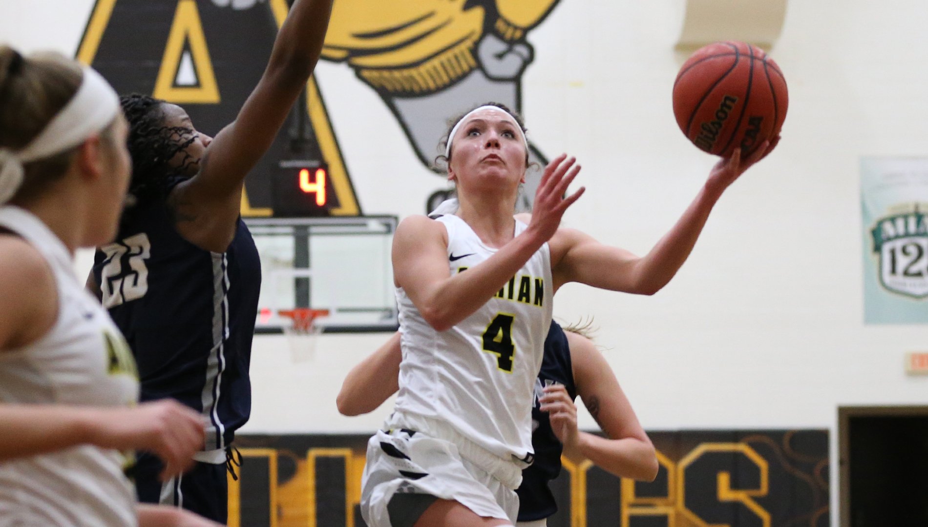 Aly Kubik eyes one of her team-leading seven points in Adrian's 65-29 MIAA loss at the hands of nationally-ranked Trine Wednesday. (Action photo by Mike Dickie)