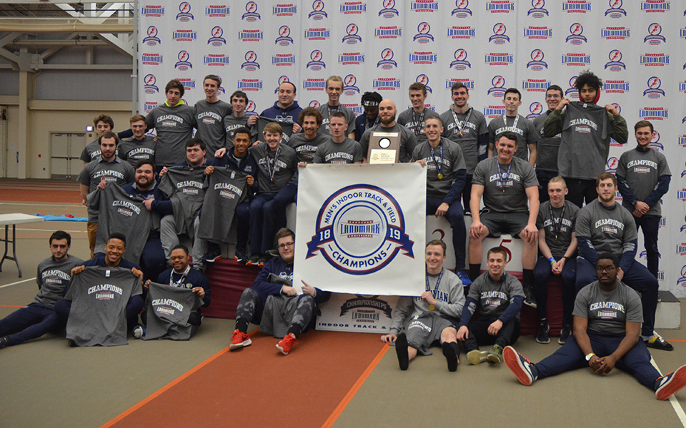 The Hounds on the podium at Susquehanna University after capturing the 2019 Landmark Conference Championship.