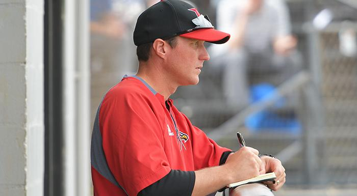 Head Coach Al Corbeil takes notes before a game at Bing Tyus Yard in Winter Haven. (Photo by Tom Hagerty, Polk State.)