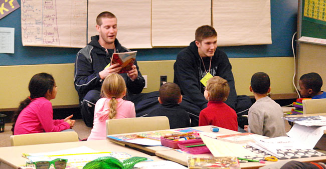 Moravian basketball reads to william penn elementary school as part of