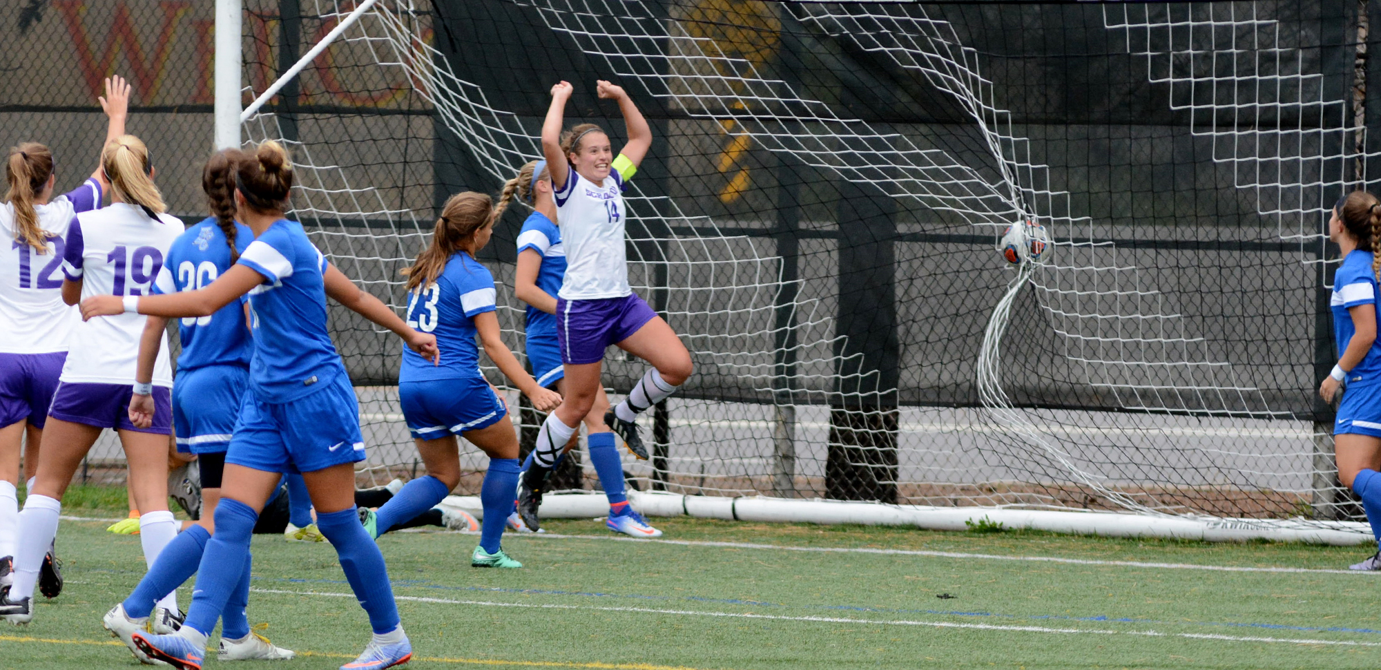 Senior midfielder Carolyn Warner celebrates her goal in the 19th minute on Saturday.