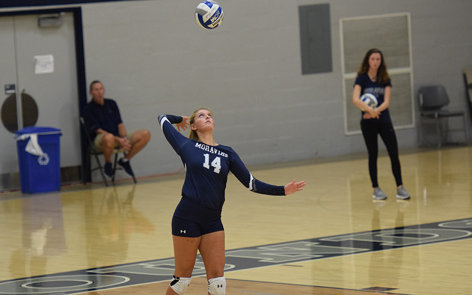 Freshman Sela Herber serves in a match versus Franklin & Marshall College in Johnston Hall.