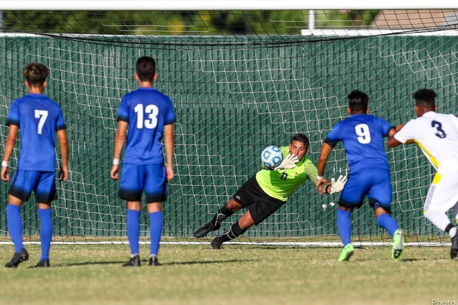 Luis Enciso makes a save on a penalty kick to help the Falcons win