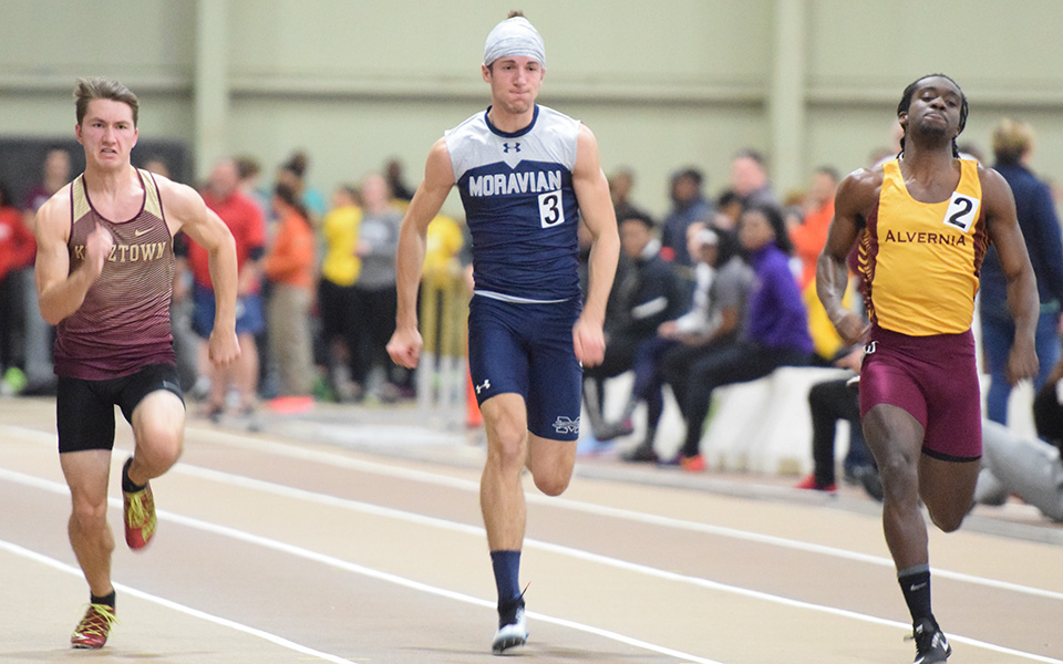Senior John Spirk runs a sprint race during the Fast Times Before Finals at Lehigh University's Rauch Fieldhouse.