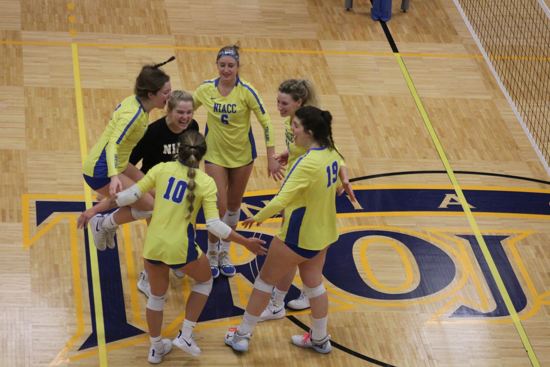 NIACC celebrates match point against Southeastern in the opening round of the regional tournament Saturday.
