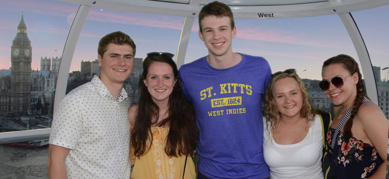 Ryan Healy poses for a photo with friends in England.
