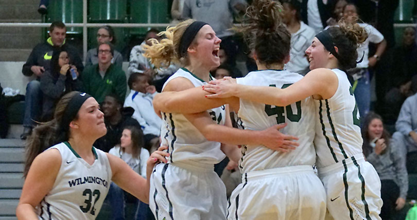 Emily Harman (32), Mackenzie Campbell, Mary Moyer and Ashley Andracki celebrates Moyer's three-pointer to lift WC to the win (Mark Huber/Wilmington News Journal)