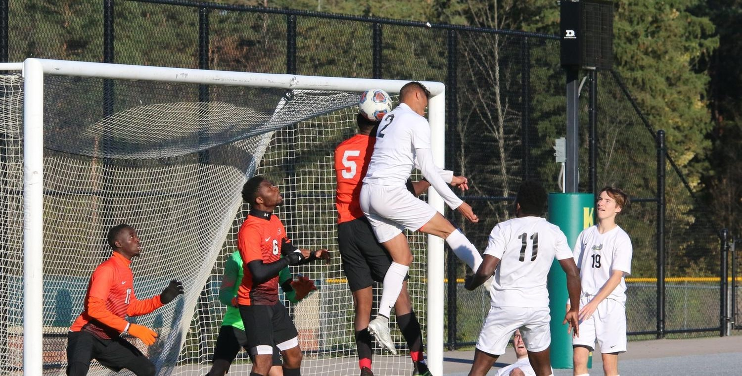 Jordan Miller (2) rose for the header in overtime for Keuka College -- Photo by Ed Webber