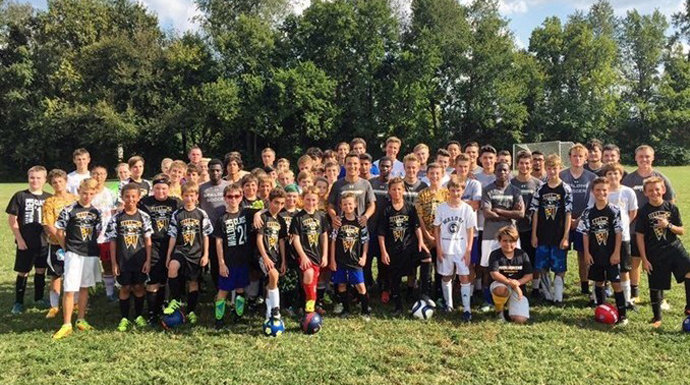 Spalding Men's Soccer Participates In Community Soccer Clinic