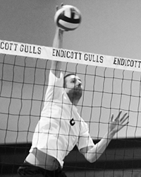 Black and white action photo of A.J. Witkofsky playing volleyball