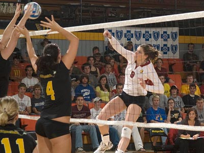 Sarah Lark drives the ball over the net in Friday's match at Michigan Tech. (Photo courtesy of MTU Photo Services)