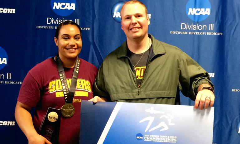 Cherae Reeves poses with Cobber throws coach Dave Reuter after winning the national championship in the shot put.