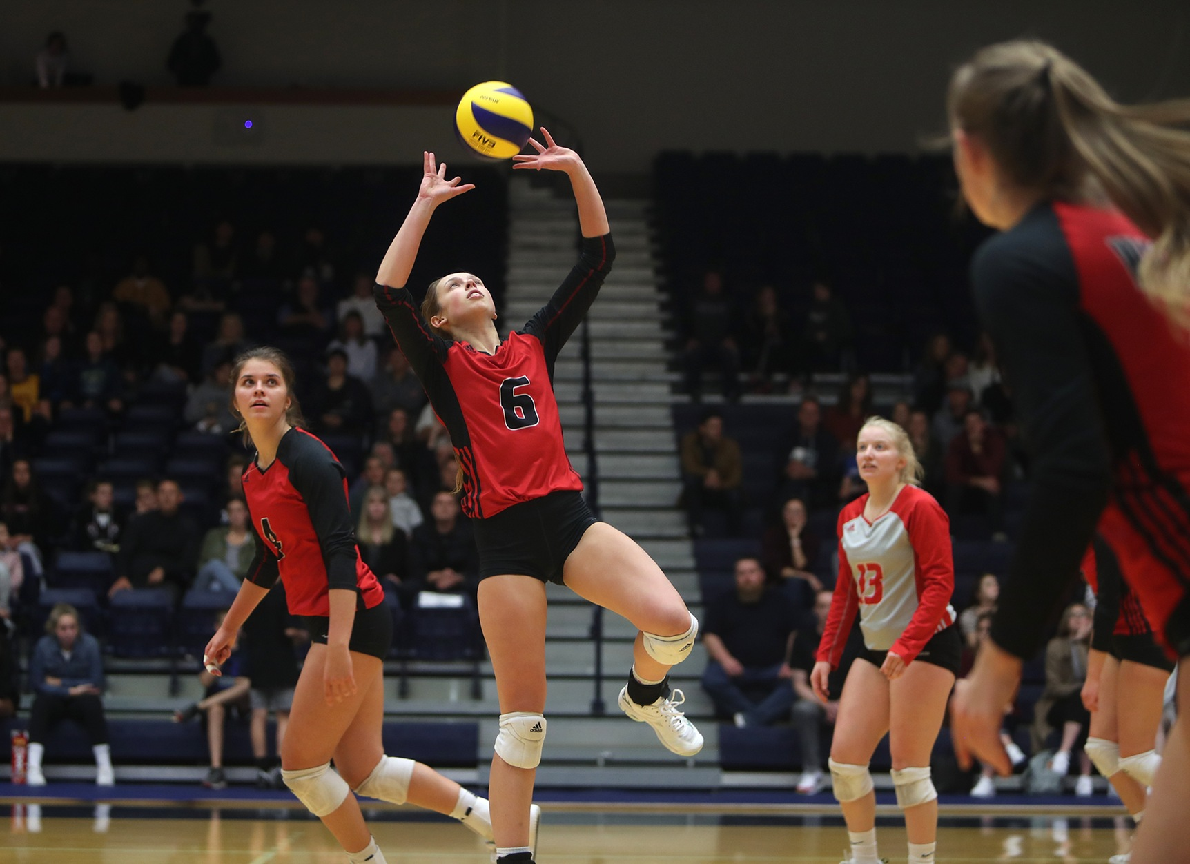 Wesmen setter Rylie Dickson sets up an attack during the women's volleyball team's match with the Trinity Western Spartans in Langley, B.C., Saturday, Oct. 26, 2019. (TWU photo)