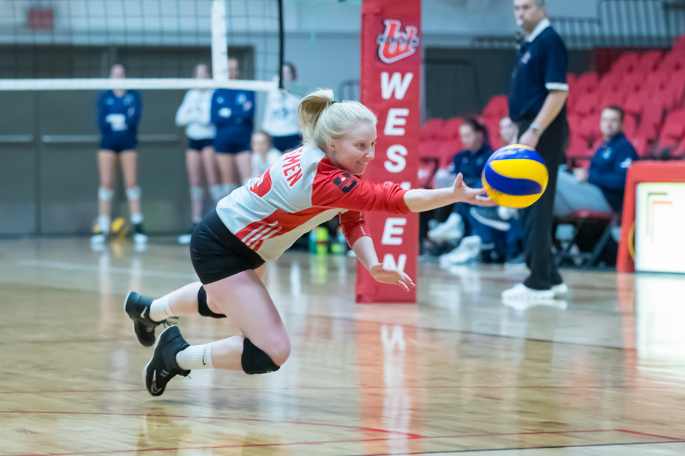 Libero Madison Fyvie lays out for a dig in the Wesmen's match with the Trinity Western Spartans Saturday, November 10, 2018. (Kelly Morton/Wesmen Athletics)