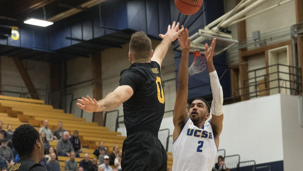 Gabe Vincent makes one of his six three-pointers on Thursday night against Long Beach State. The senior scored a career-high 28 points in the heartbreaking 70-69 loss. (Photo by Eric Isaacs)