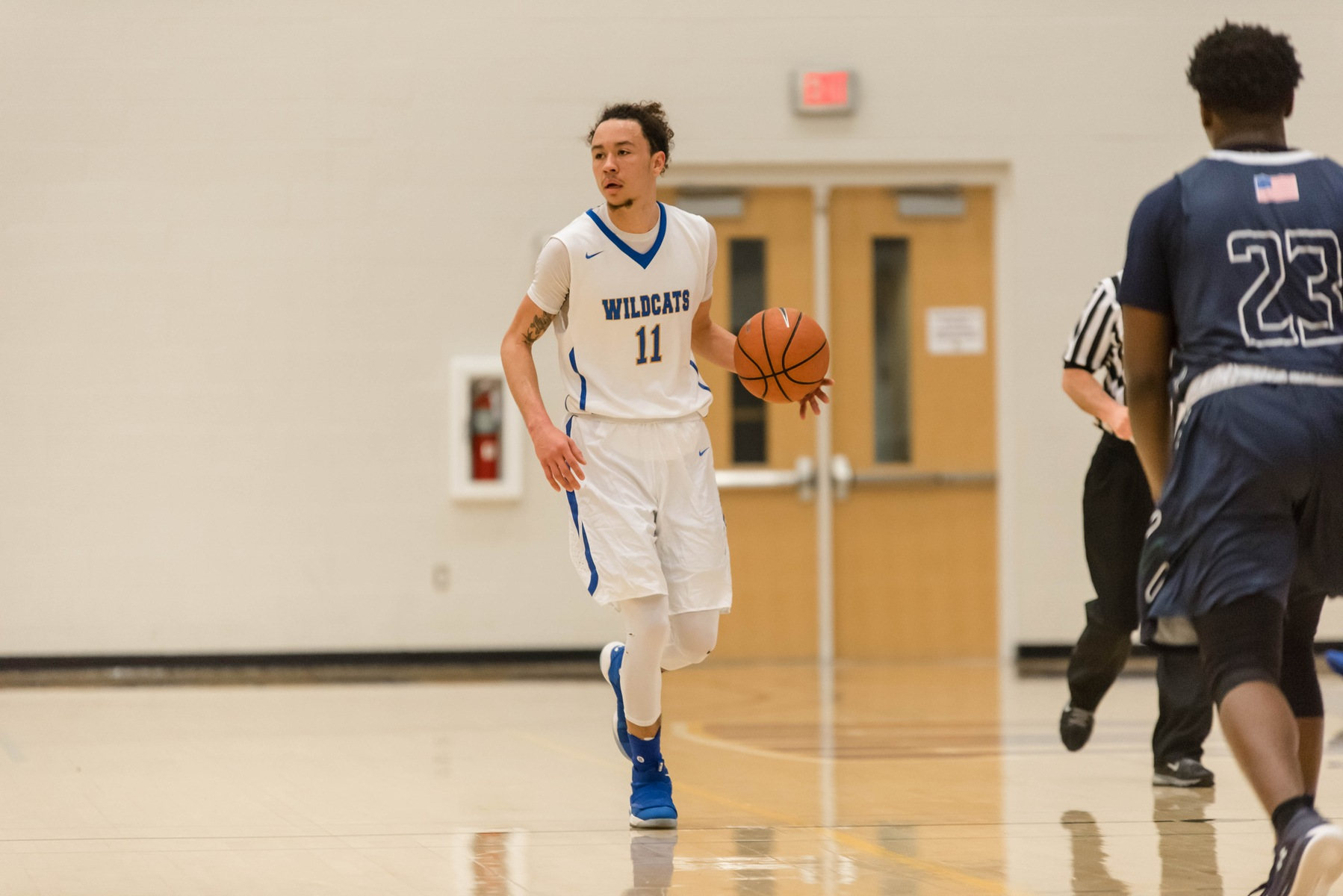 Men's Basketball Opens Season With Conference Win
