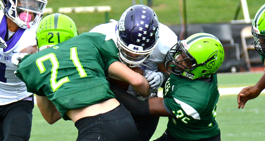 Freshmen Olen Kiel (21) and Leroy Wilson combine for a tackle in Saturday's loss to Mount Union. (Wilmington photo/Randy Sarvis)