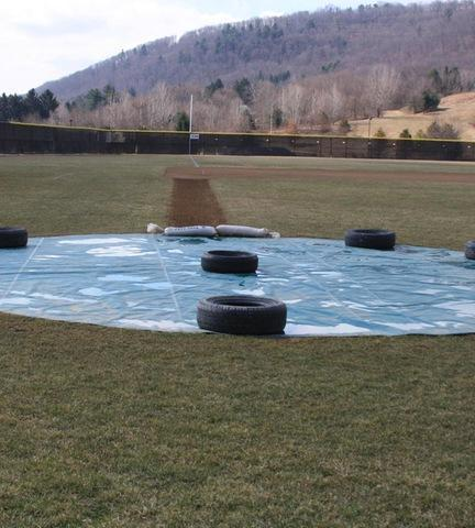 Picture of homeplate area covered by tarp