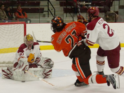 Pat Nagle makes one of his 29 saves in Saturday's series finale decision over Bowling Green State. (Photo by Scott Whitney)