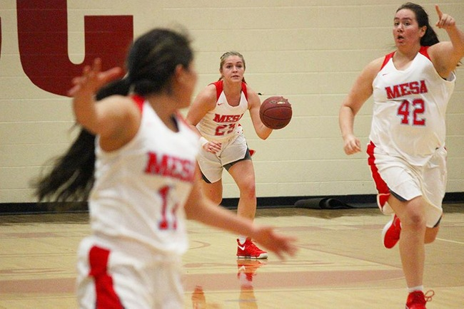 Mesa's Courtney Colleary leads a T-Bird fast break with Madison Chesarek (#42) and Lynnae Mitchell (#11) out in front. (photo by Aaron Webster)