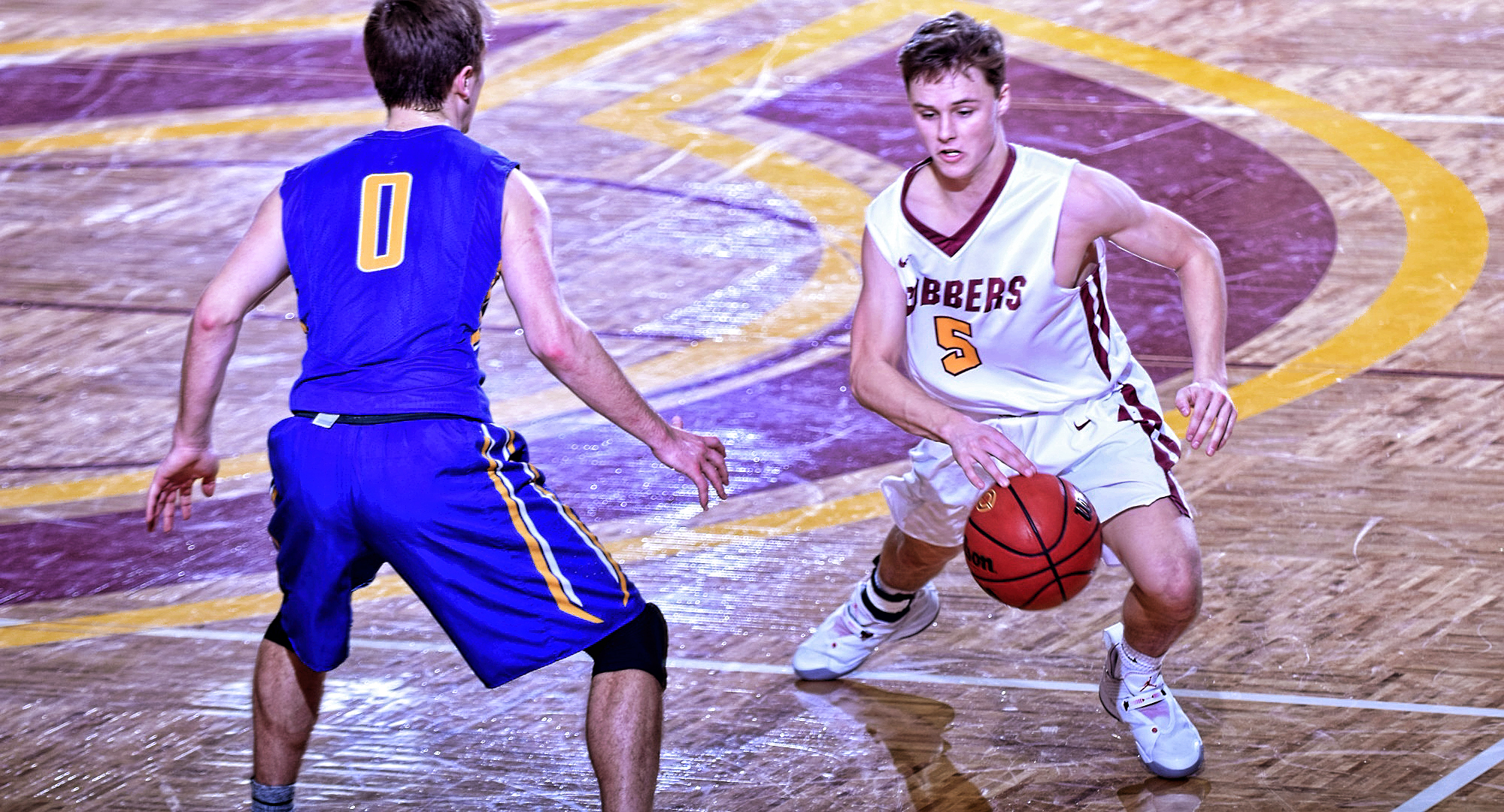 Freshman Jackson Jangula beats a defender off the dribble on his way to the basket and two of his career-high 26 points in the Cobbers' win over St. Scholastica.