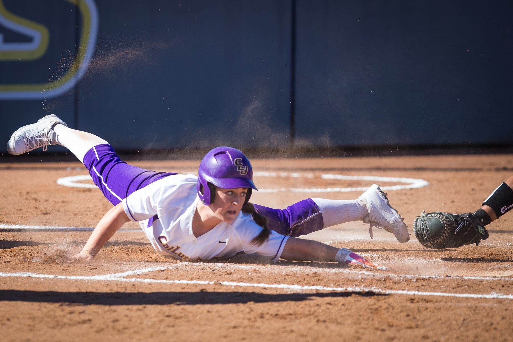Kendall Marinesi slides into home. Photo by Dave Donovan.