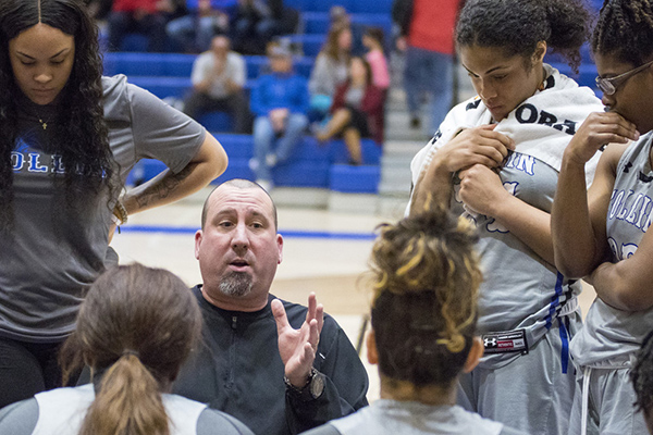 Lady Cougars Coach Jeff Allen instructs his players during a timeout.