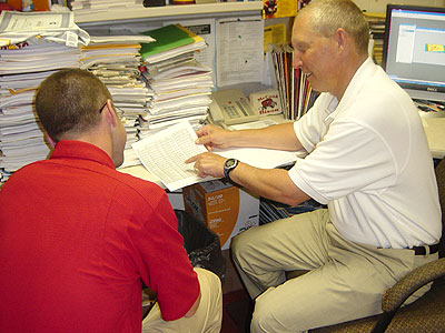 FSU Athletics Director Tom Kirinovic (right) speaks with Associate AD Jon Coles (left)