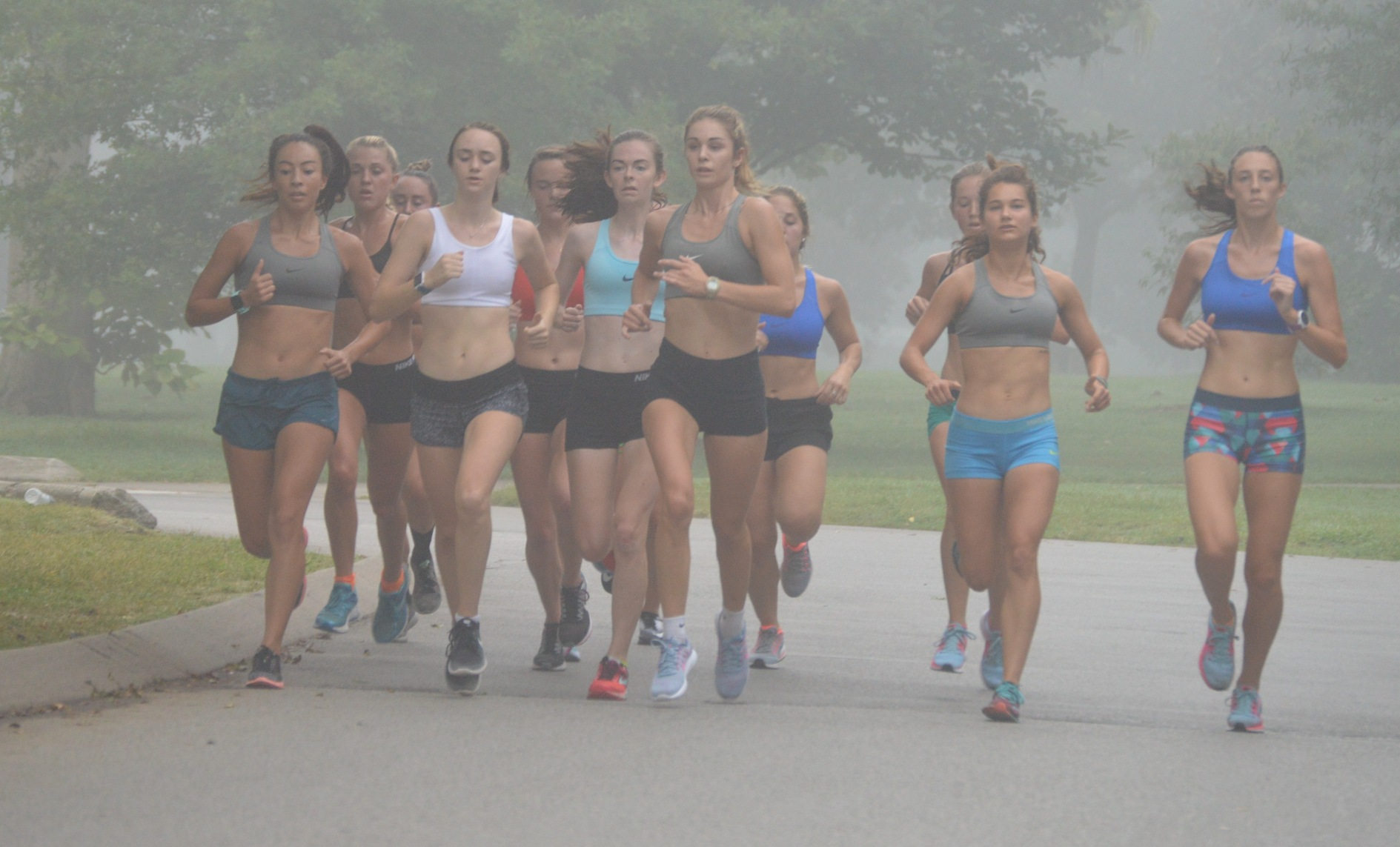 The Belmont women's cross country team runs through the early morning fog at Centennial Park during a preseason training session in August.