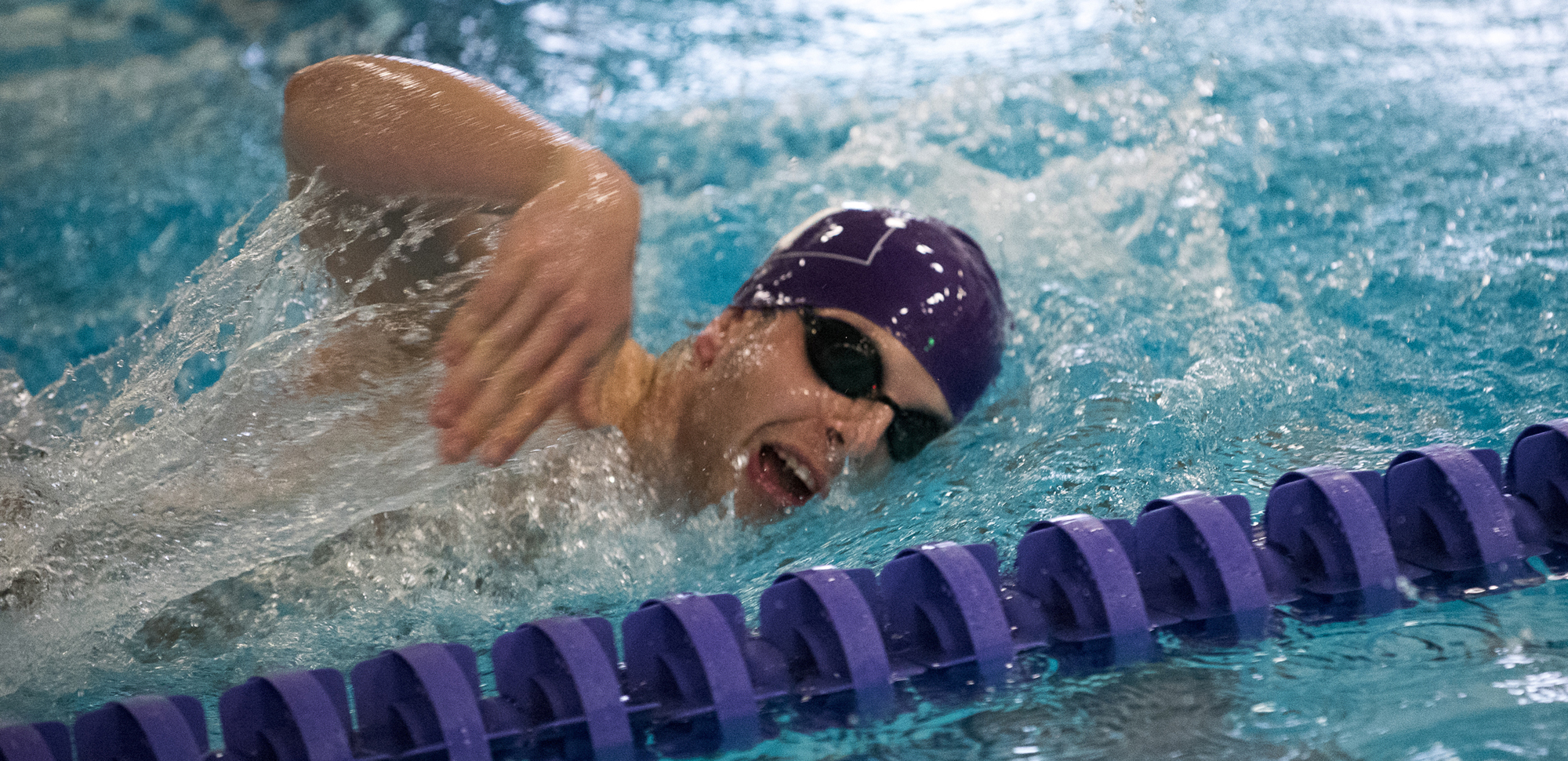 Dan Muenkel won the 200 backstroke and was second in the 100 backstroke on Saturday as the Royals defeated Juniata and Goucher.