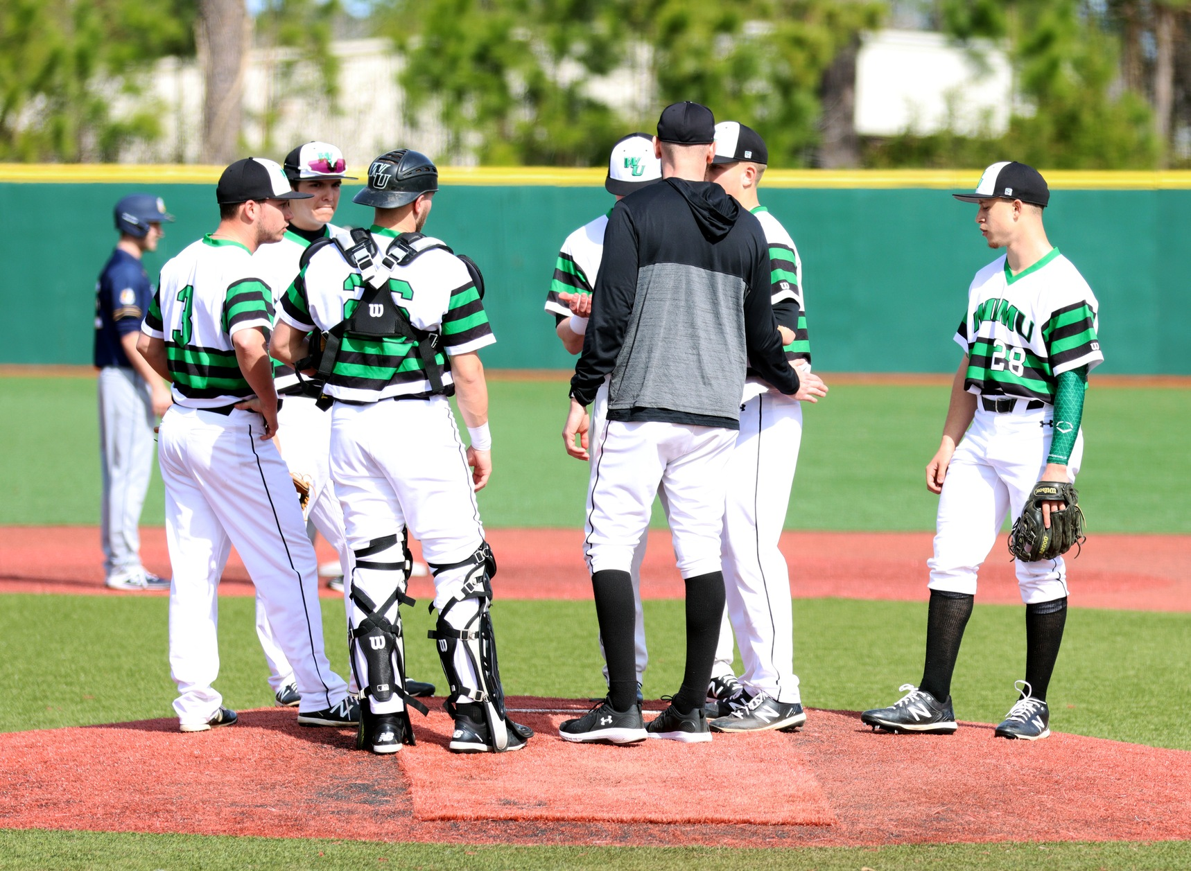 Photo by pitching coach Anthony Cimabue talking to starter Matt Warrington. Copyright 2020; Wilmington University. All rights reserved. Photo by Dan Lauletta. February 23, 2020 vs. New York Tech in Myrtle Beach.