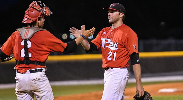 Cody Oerther (left) congratulates Pat Doudican after he pitched a complete game shutout in a 10-0 win over South Florida. (Photo by Tom Hagerty, Polk State.)