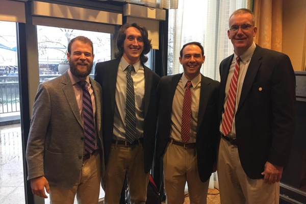Lynchburg lacrosse coaches pose at the IMLCA Convention. Left to right: Eric Lombardo, Aaron Murphy, Jon Lombardo, Steve Koudelka.