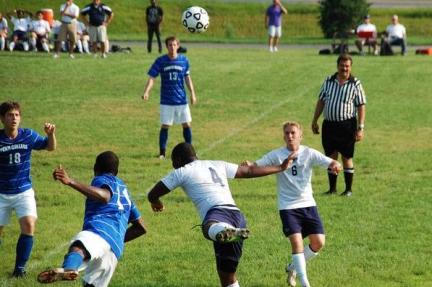 Schuylkill and Penn College players battle for ball in the air